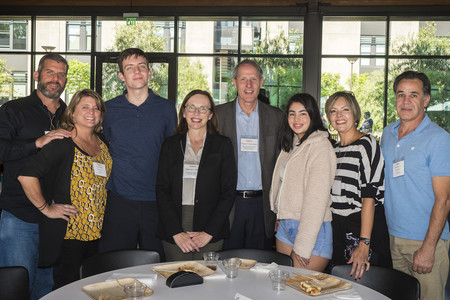 Families gather with President Thomas Rosenbaum and Professor Katherine Faber at Family Weekend.