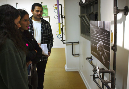 Guests at the October 13 Pasadena ArtNight at the Armory Center for the Arts view an untitled photo by Caltech graduate student Pooya Vahidi.