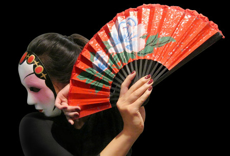 photo of Chinese dancer with opened fan