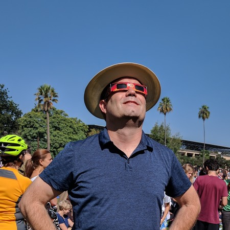 Mueller, a senior gift planning officer in the Office of Gift Planning, views the recent eclipse on campus.