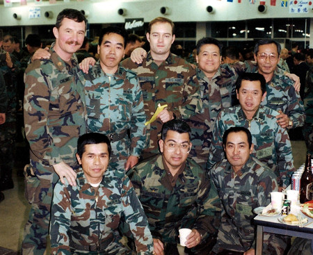 Oliver Mueller (center, top row) served eight years in the U.S. Army Reserve as a first lieutenant and detachment commander of a movement control team after earning an Army ROTC scholarship to pay for college. The photo was taken in Japan during a j
