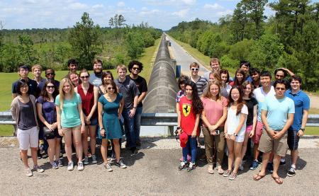 LIGO SURF students on beam pipe