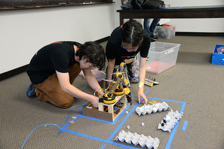 At the 2016 Science Olympiad event at Caltech, participants from Canyon Crest Academy set up a robotic arm.