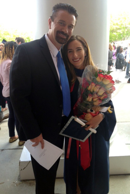 Winiecki poses with his daughter at her graduation in May.