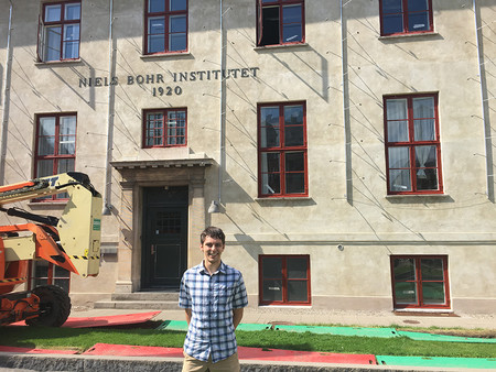 Physics student Noah Huffman in front of the Niels Bohr Institute.
