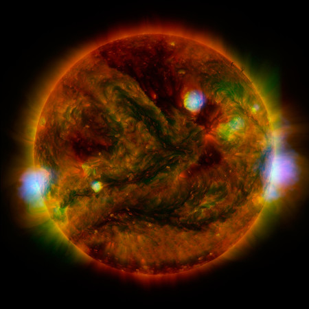 An image of the sun in several different colors