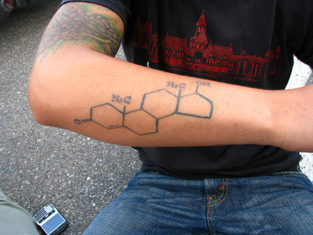 A man's forearm with a tattoo of the testosterone molecule