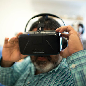 A man uses a virtual-reality headset.