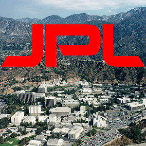 """aerial view of JPL with the letters """"JPL"""" superimposed"""