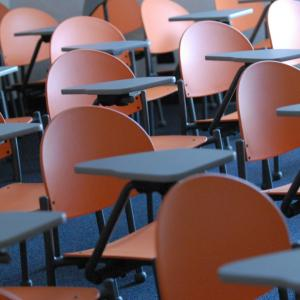 photo of empty classroom chairs and desks