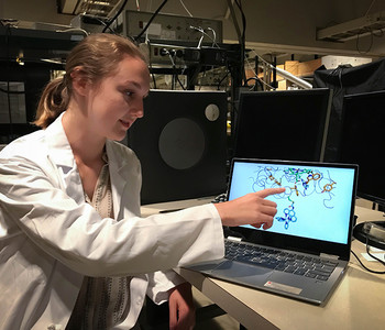 Perry Hicks, a student from Mercer University, shows the molecular structure of a protein on a computer screen.