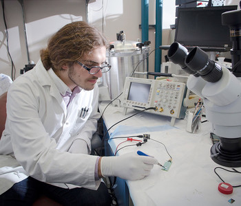 A student engages in research in a lab.