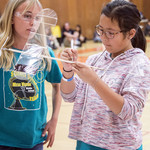 Emilia Ellegaard and Amy Wang, from Mesa Verde Middle School, prepare to launch their rubber-band-powered airplane; their goal was to have the airplane stay aloft as long as possible.