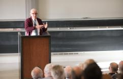 photo of John Sutherland presenting a lecture at Caltech