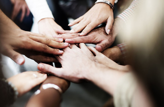 photo of many hands together