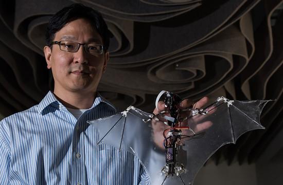 photo of Soon-Jo Chung holding a mechanical bat