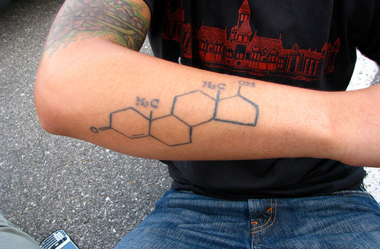 photo of man's arm with testosterone tatoo