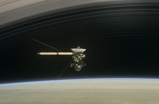 illustration of the Cassini spacecraft within the rings of Saturn