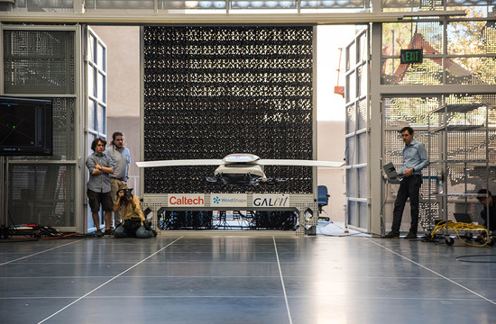 photo of a scale model of the Autonomous Flying Ambulance being developed at CAST hovering in front of the wall of fans