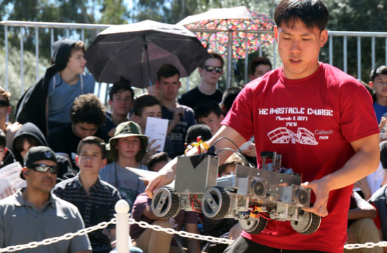 Kyung Park, of Team Soul, places a robot for one of the early heats.