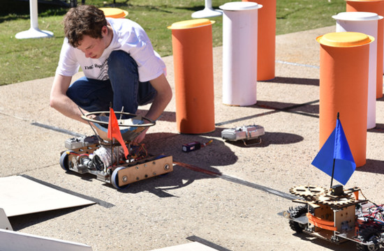 Team Soul's Joel Kosmatka prepares a robot for the start of a new heat.