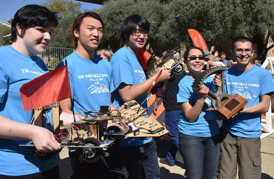 The V15TA team— (from left) Allison Penn, William Yu, Yunsang Choi, Mayra Melendez and Eduardo Plascencia —won first place by having its robots successfully navigate an obstacle course.