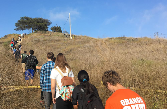 Caltech freshman hike up a hill during a geology hike as part of Frosh Camp.