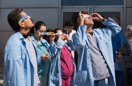 photo of Caltech staff outside to view the eclipse
