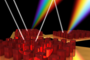 An artist's representation of how a metasurface composed of nanoposts disperses light.