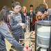 Under the supervision of event supervisor Henry Zamora (right), Carin Dang and Michelle Lim, from Oak Ave Intermediate School, prepare to test their balsa wood tower. Their challenge was to build the lightest tower that can still hold up to 15 kg of sand.