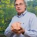 Richard Andersen holding a model of a brain.