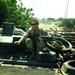Shane Eagan, an electrician from Caltech's electrical shop, rides atop a vehicle in Mogadishu, Somalia, circa 1993.