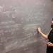 Yeorgia Kafkoulis at a chalkboard