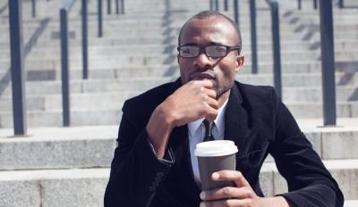 Thinking businessman during coffee break