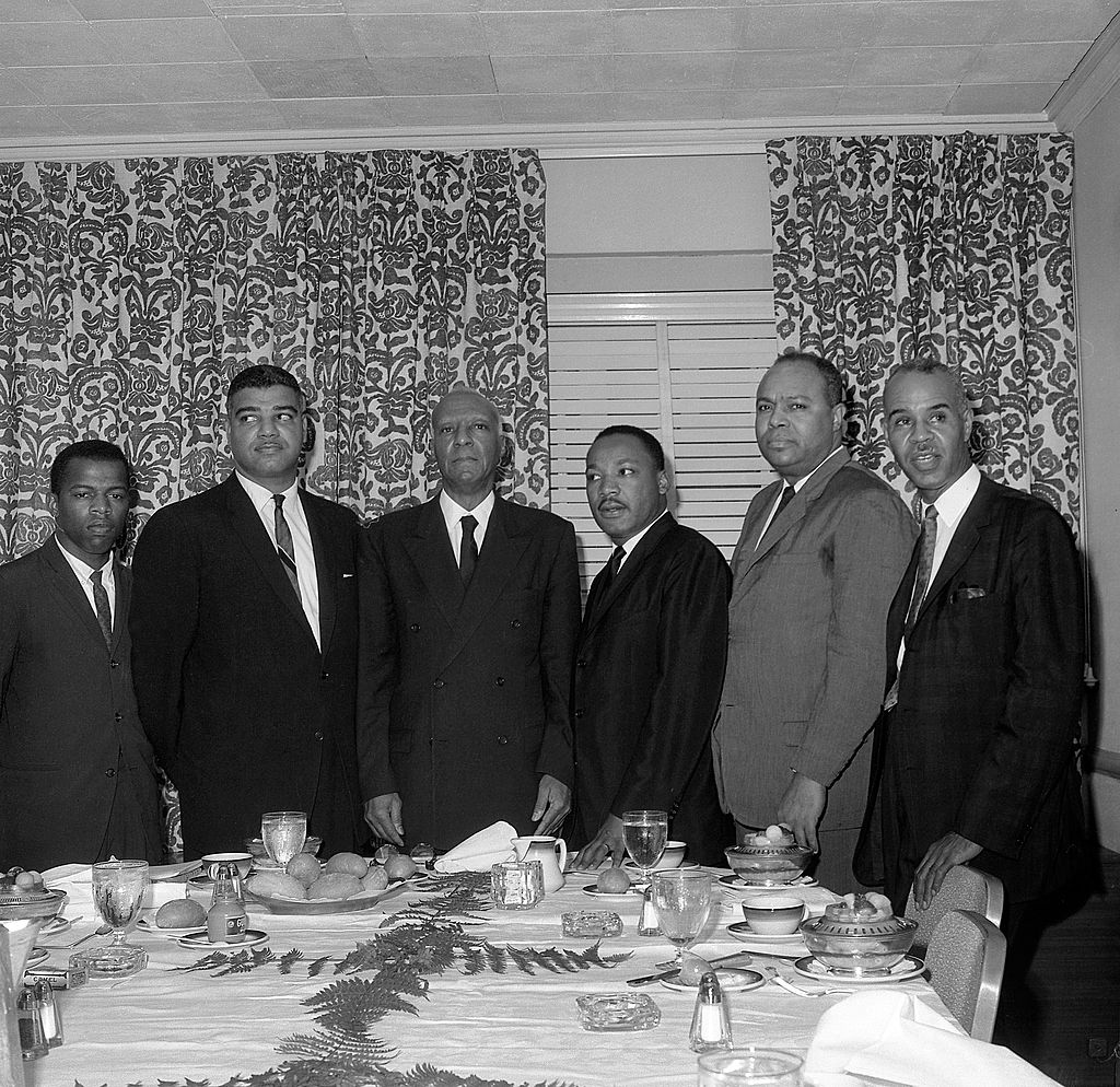 Photo credit: AFP / Stringer (John Lewis, Whitney Young, Philip Randolph, Martin Luther King, James Farmer and Roy Wilkins, meet March 6, 1963 in Roosevelt Hotel in New York)