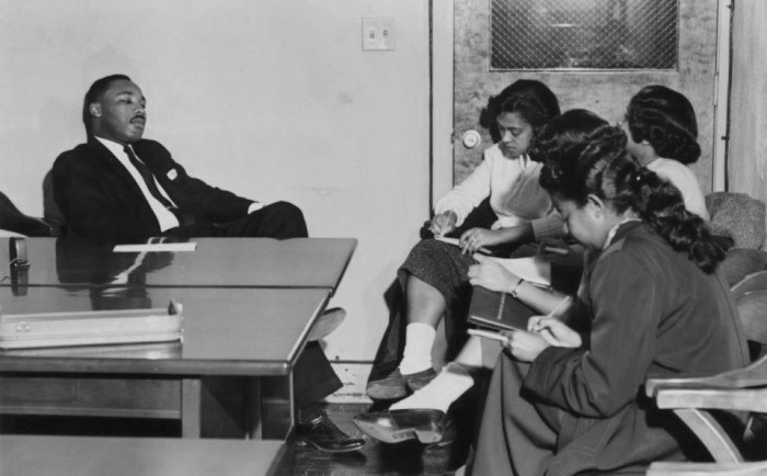 Dr. Martin Luther King, Jr. on campus at Bennett College being interviewed by Bennett Belles when he spoke there 60 years ago in 1958/Photo Credit: Bennett College