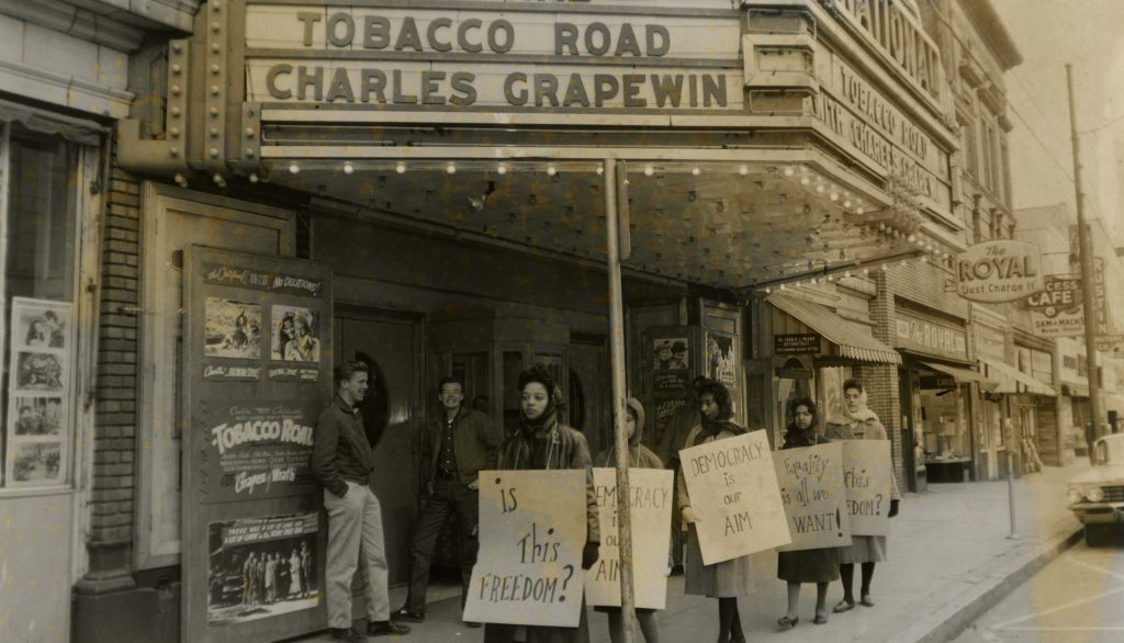 Students protest outside of a local theater over an offensive film/Photo Credit: Bennett College