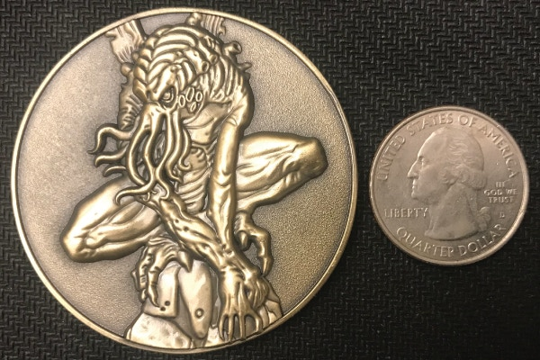 Cthulhu Coin next to Quarter