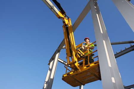 Working under beams poses a risk of being pinned while in a boom lift