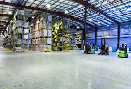 Forklifts in a large warehouse