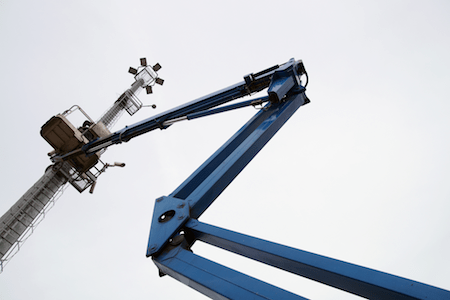 Articulating Boom Lift being used for Light Tower