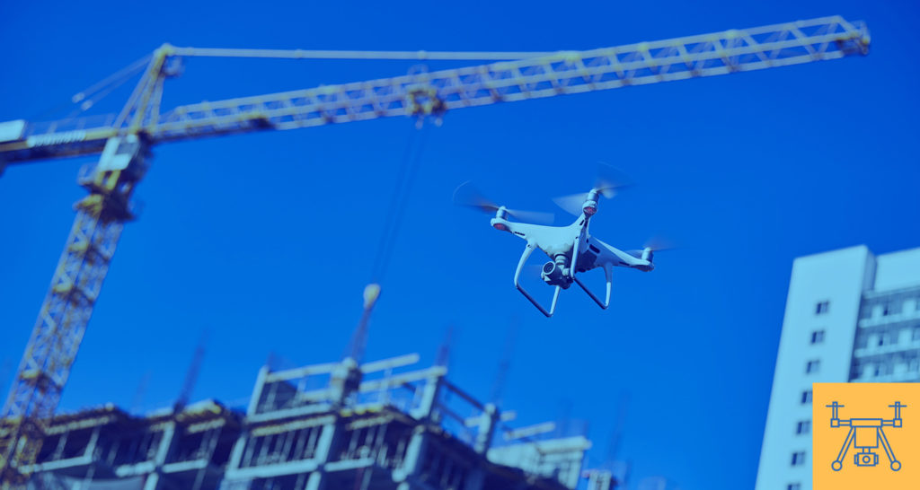 A drone flies over a construction site to provide aerial footage.