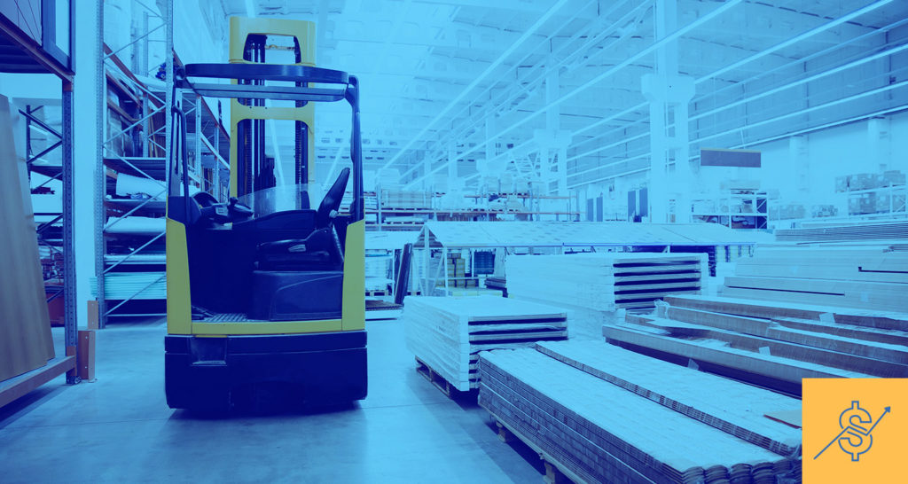 A forklift moves building materials in a warehouse as costs continue to rise.