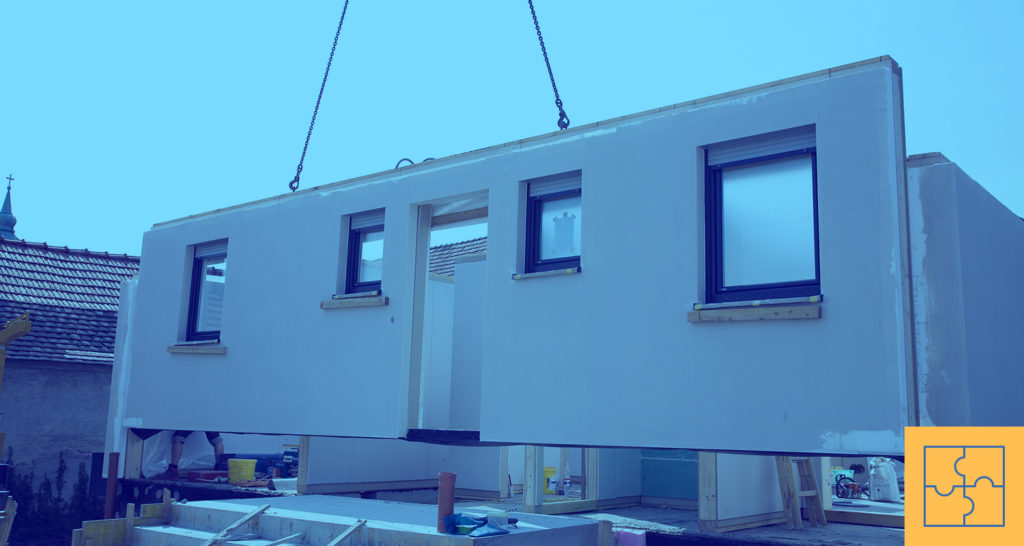 A prefab home is being built off-site in modular units.