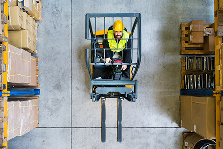 birds eye view man warehosue forklift