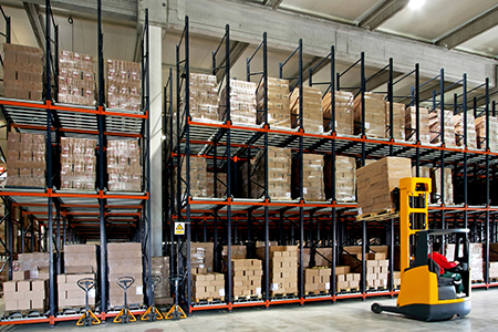 forklift loading warehouse shelves
