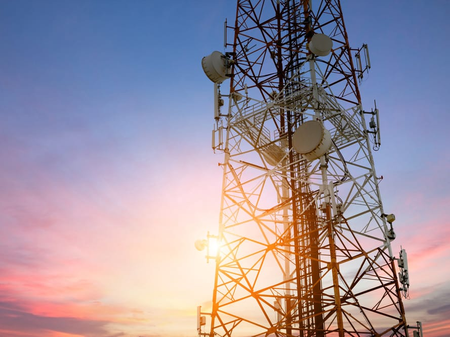 Cell tower with color sunset background