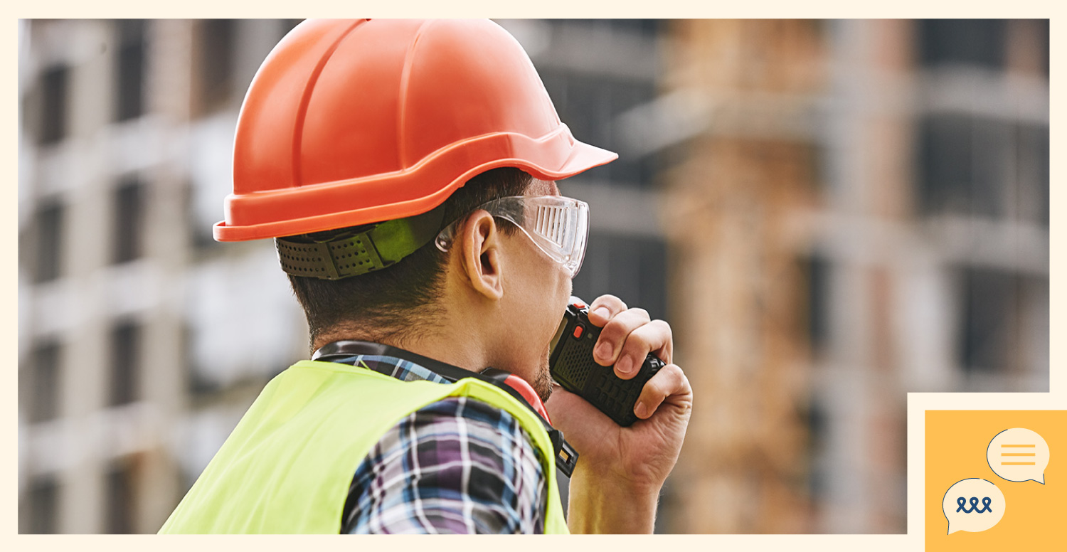 construction worker communicating with team on a radio