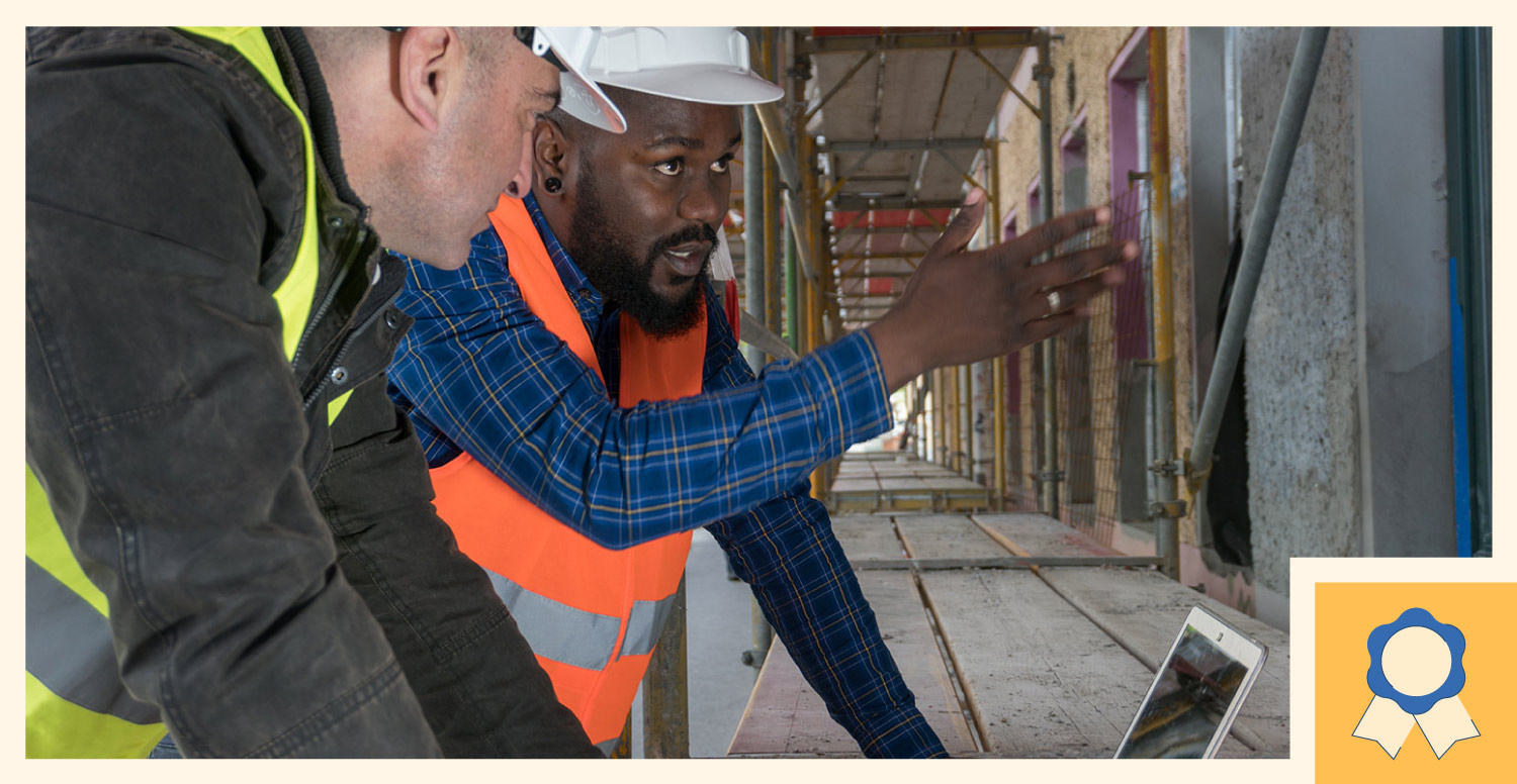 construction worker explaining a project issue to another construction worker