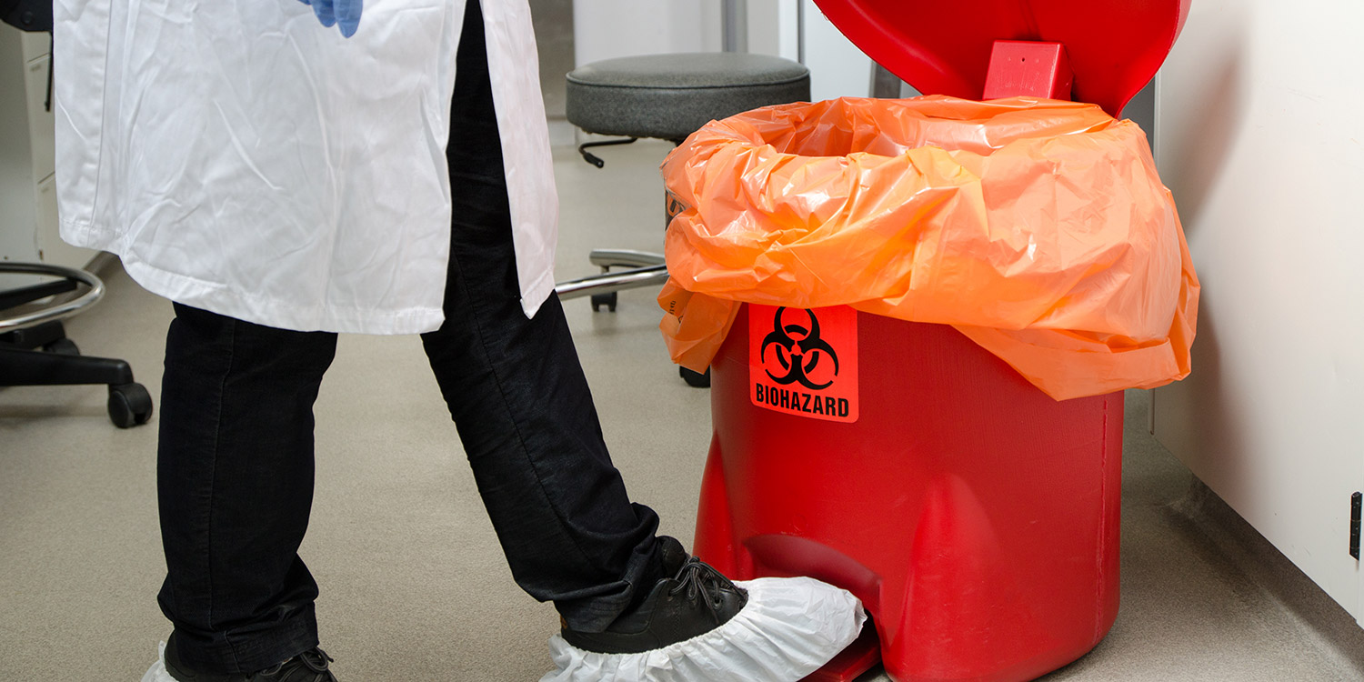 A medical waste trash can with biohazard label